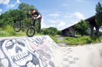 Cody Smiglewski, Footjam Whip in Bloomington, MN. A few of us had heard rumors of this DIY drainage bank spot, but no one knew exactly where it was. A quick Google Satellite search turned up a possible hit that ended up panning out along the banks of the Minnesota River. After cleaning up a bit of the crust and sand, the spot was ready to ride and Cody pulled off the move of the mission.